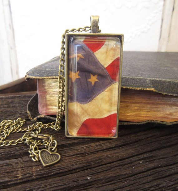 A very patriotic, vintage American flag set in an antique bronze pendant!  What better way to show your loyalty and love for the great