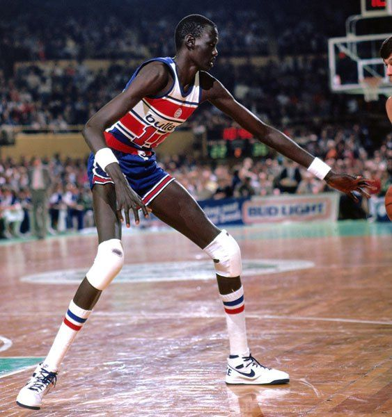 Manute Bol, a 7'7″ Dinka tribesman from the Sudan who was selected by the Washington Bullets 31st overall in the second round of the 1985 NB...