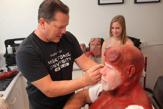 """Give 'im hell, boy: As a favor for """"Make-a-Wish,"""" Ron Perlman in """"Hellboy"""" character makes an appearance for a young fan; an accompanying FX makeup artist shows the boy how he can become a Hellboy Wonder."""