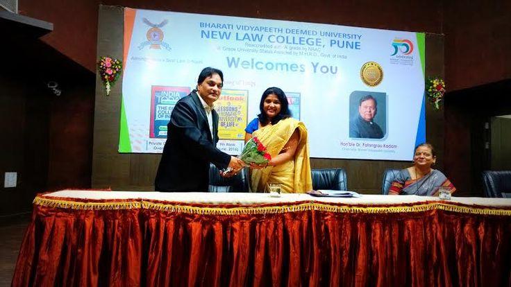 Prof. Dr.  Mukund Sarda, Dean  & Principal felicitating Adv. Vibha Mane, Career Consultant at Induction programme for fresher.