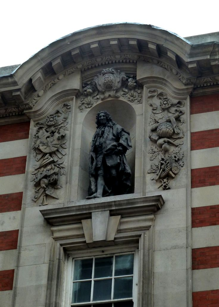 Statue of Sir John Cass, situated high above the front entrance