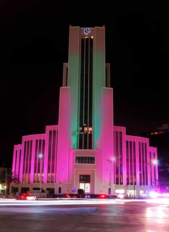Night view of Edificio El Moro home of 'Loteria Nacional' building.  Paseo de la Reforma.  Mexico Cito, MEXICO.