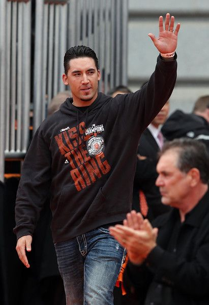 San Francisco Giants' Travis Ishikawa acknowledges the crowd as they celebrate their World Series championship at Civic Center Plaza in San Francisco, Calif., on Friday, October 31, 2014.  (Jane Tyska/Bay Area News Group)