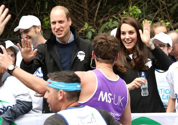 Prince William, Duke of Cambridge and Catherine, Duchess of Cambridge hand out water to runners during the 2017 Virgin Money London Marathon on April 23, 2017 in London, England. The Duke and Duchess of Cambridge and Prince Harry, are spearheading Heads Together, in partnership with eight leading mental health charities, that are tackling stigma, raising awareness, and providing vital help for people with mental health problems.