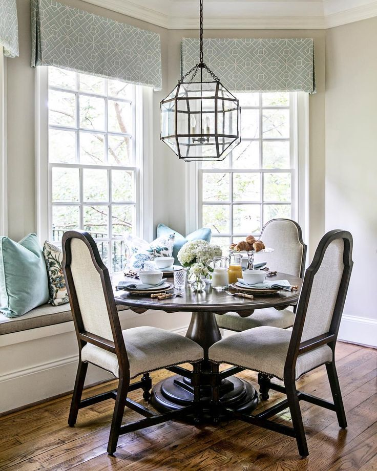 Breakfast nook by atlanta designer clary bosbyshell featuring the morris medium lantern by suzanne kasler