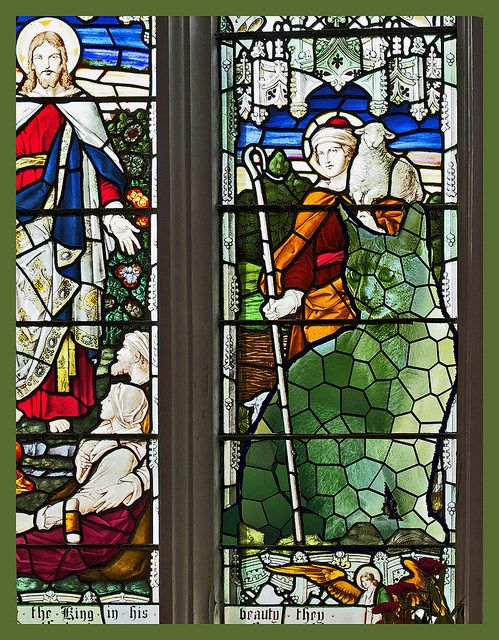 A centuries old stained glass window holds a surprising rendition of what appears to be The Topiary Cat as a kitten.: