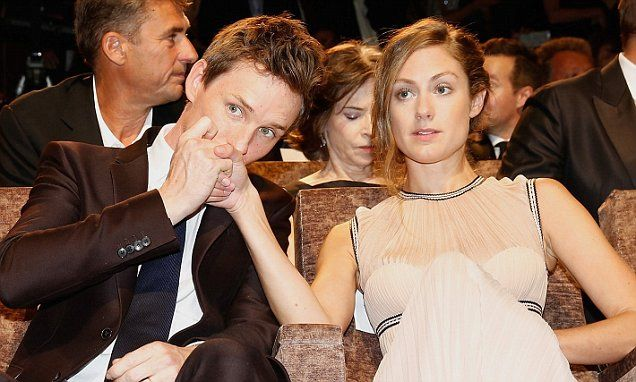 Eddie Redmayne kisses wife Hannah Bagshawe affectionately