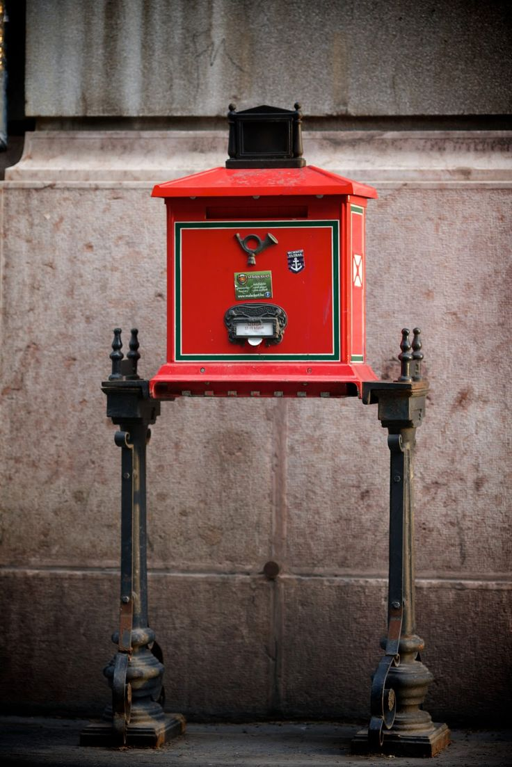 A traditional red post box in Budapest.