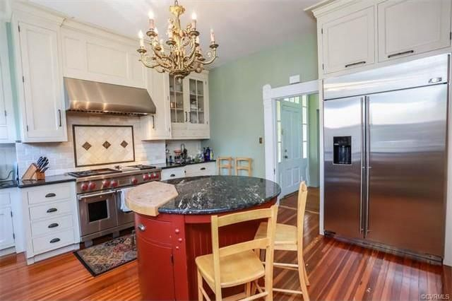 Round kitchen island...love...maybe with a full butcher block