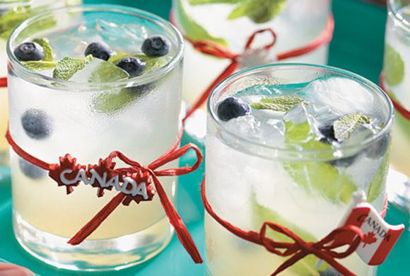 Canadian Mojito: Rye and blueberries add a Canadian twist to this traditional Cuban cocktail. Garnish each glass with skewered blueberries and mint sprig. #recipes