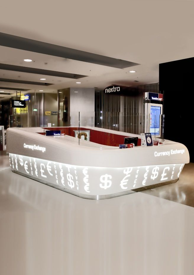Corian® Backlit travelex counter.