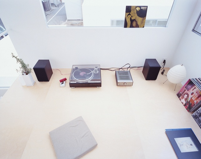 """The stereo in Unit A's third-floor bedroom/study box is just a tease compared to the windowless basement """"audio room,"""" where Moriyama spends private time in the company of 2,000 vinyl albums, mostly jazz. Here, a few albums are accompanied by Noguchi's Akari Lamp 1N."""