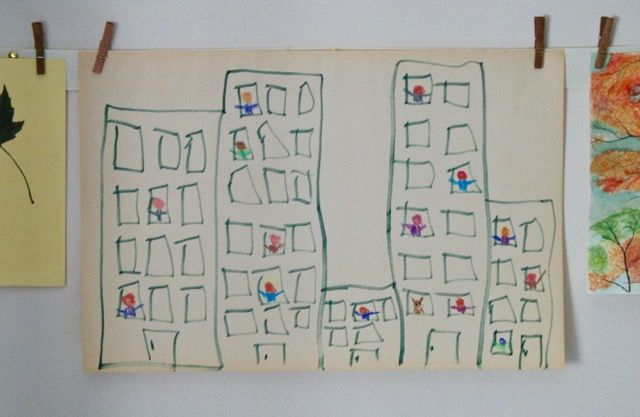 City Shapes Art Activity inspired by Nana in the City by Lauren Castillo - Invite your young reader to explore how basic rectangles can transform into buildings and windows, then fill the windows with the faces of friends and family! - offtheshelfblog.com