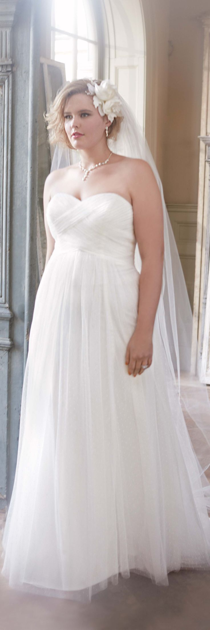 Read about beautiful wedding dresses for plus size apple shape women (photo David's Bridal) - click to read: http://www.boomerinas.com/2014/10/08/wedding-dresses-for-your-body-type-apple-shapes-plus-size-tummies/