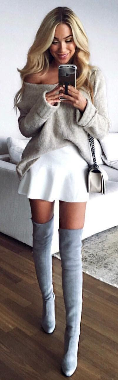 #winter #outfits gray off-shoulder sweater, white mini skirt, and pair of gray knee-high stiletto boots