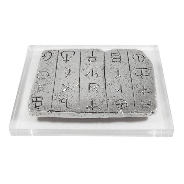 Linear B is the oldest surviving record of the Greek dialect and it was a Mycenaean adaptation of the earlier Minoan Linear A script.  Free rendering of the letters of the ancient script, based on images of ancient clay tablets, which were found during excavacations in Crete. 1500 - 1200 B.C., Crete Dimensions of the plaque: 10 cm x 7,5 x 5 mm Dimensions with the acrylic stand: 13 cm x 13 cm x 2 cm Silver 999°  paper-weight, on an acrylic base.