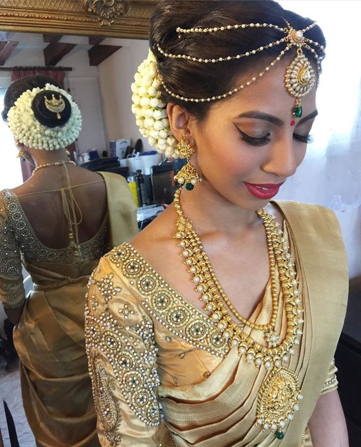 South Indian bride. Gold Indian bridal jewelry.Temple jewelry. Jhumkis. Gold silk kanchipuram sari.Bun with fresh flowers. Tamil bride. Telugu bride. Kannada bride. Hindu bride. Malayalee bride.Kerala bride.South Indian wedding.
