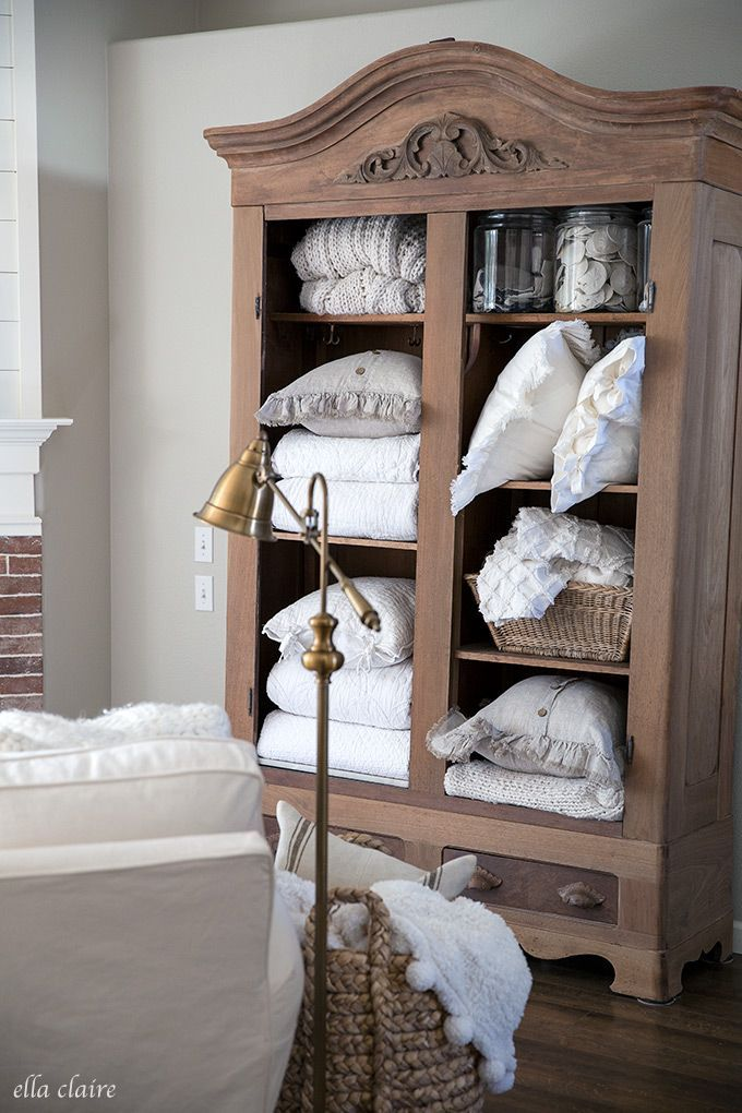 Warm And Cozy Fall Family Room Extra Linen Storage In A Styled Open Antique Armoire Family Room Design Antique Living Rooms Family Room