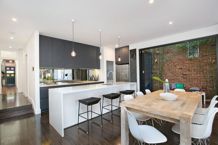 Dining area opens to timber-decked side courtyard. Smeg kitchen appliances & large walk-in pantry.