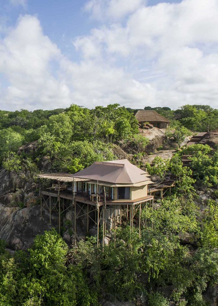 Mwiba Lodge in Tanzania, sits on stilts high in the trees in Tanzania. Elegant, woody and romantic, you will feel echoes of an ancient lifestyle in a boulder-strewn landscape. Timbuktu Travel.