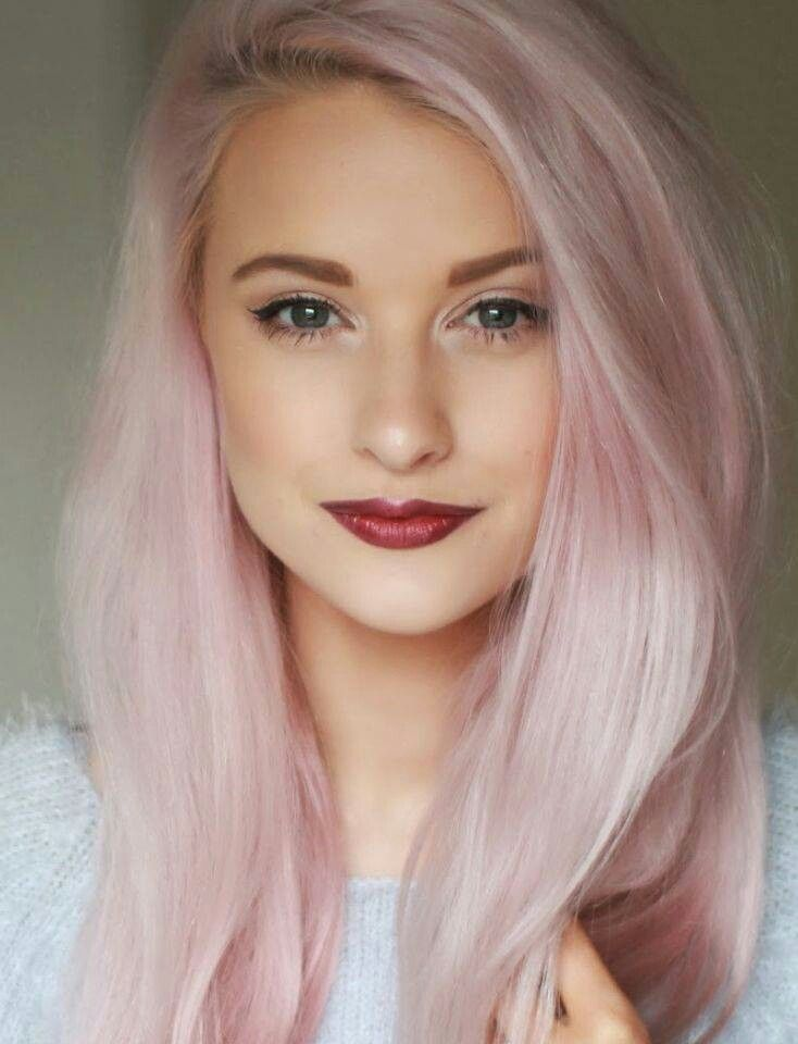 Pastel pink hair and red lipstick.