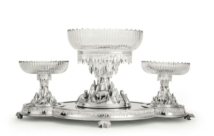 "A three-piece English silver-plated and cut-glass ""Arctic"" garniture set with matching mirror plateau, circa 1876."