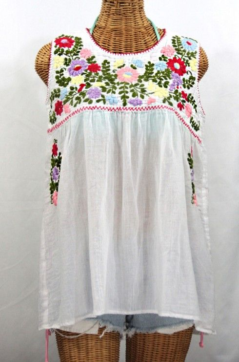 """Just in time for Spring in the Souther Hemisphere!  The sleeveless """"La Pasea"""" Embroidered Mexican Style Peasant Top in White, $48.95."""