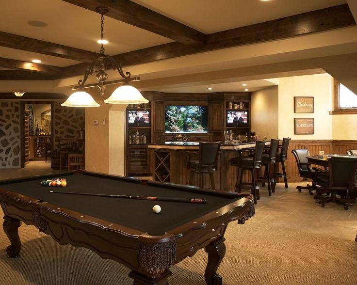 Incredible Game Room decorating ideas for Handsome Family Room Mediterranean design ideas with Alder trim aquarium bar bar stools beam ceiling black onyx black pool