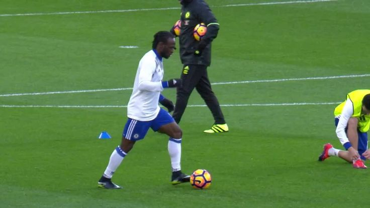 Victor Moses warming up at Stamford Bridge.. .