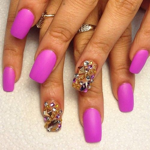Matte purple pink nails with gold accent nail and studs