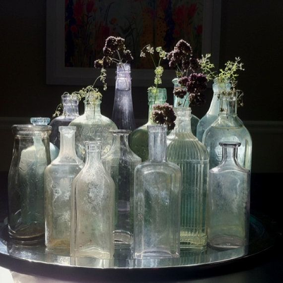 85 best images about bottles of beauty on pinterest for Glass bottle centerpieces