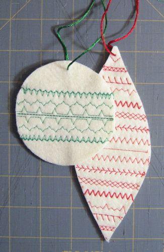Using stitching to add decorations to felt baulball cutouts.