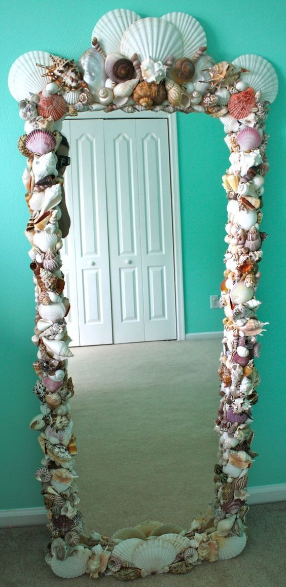 DIY Shell Mirror Purchased shells from Michael's and other craft stores.  Used 40% off coupons and spent approximately $60 in shells.  I already had the wood framed mirror.  I did use a TON of hot glue and spent many hours on this but I am very happy with