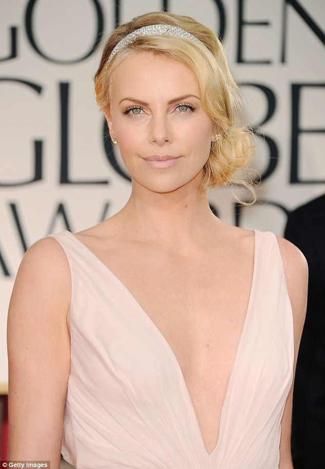 Busy girl:Charlize Theron has revealed she doesn't agree with claims that Hollywood is ageist towards women by insisting she works more now than she ever did when she was in her twenties