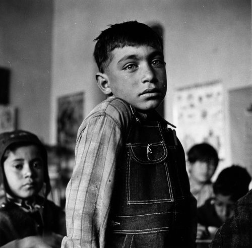 Hispanic boy in the grade school, Questa, New Mexico. 1943. -