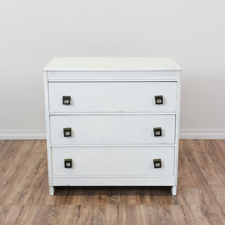 This small white dresser features a solid wood construction and is painted white. The square drawer pulls give it a lot of character and a unique look. Matching pieces available. #eclectic #dressers #shortdresser #sandiegovintage #vintagefurniture