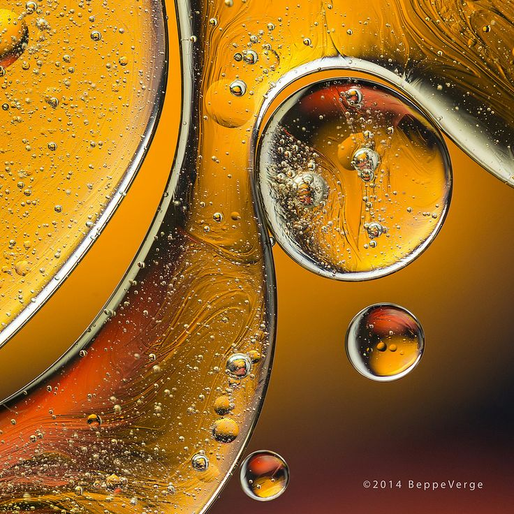 Oil & Water, Macro photography of a few drops of oil on water, no photoshop.