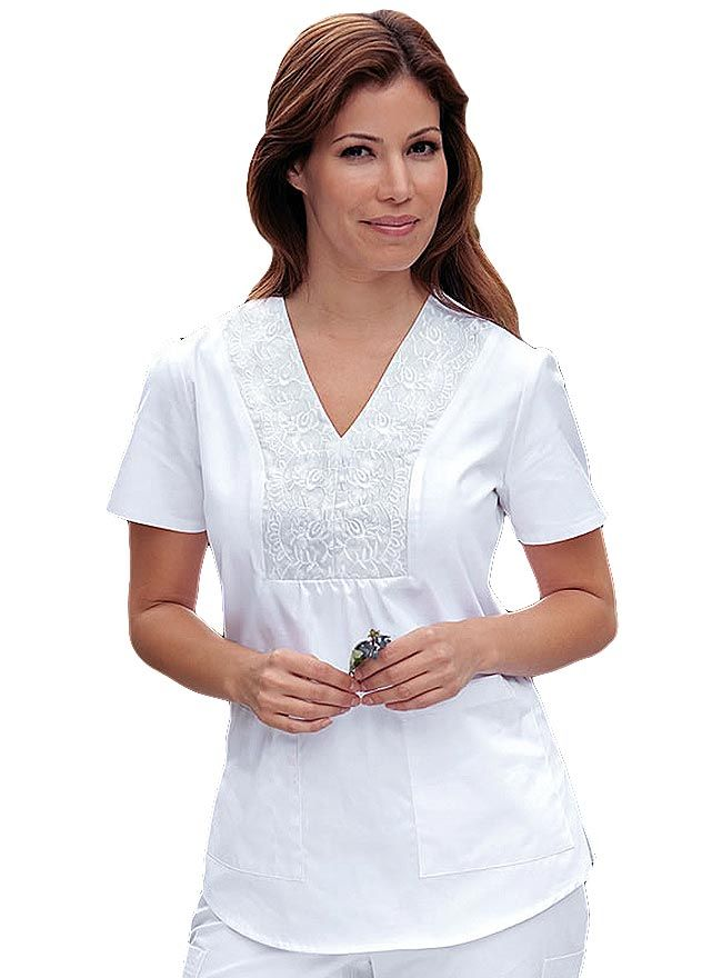 Look stylish with this embroidered scrub top from Barco Prima. This v-neck top features an embroidered detailing plus shirring on the neckline.