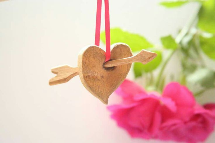 Small heart decoration with arrow through it.