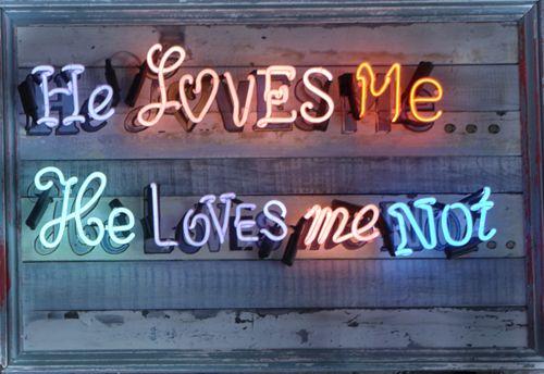 'He loves me, he loves me not' Neon by artist Chris Bracey
