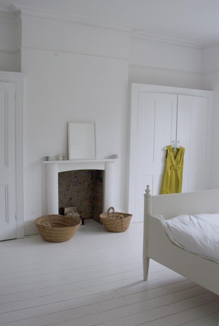 White and airy bedroom with nice fitted cupboards...
