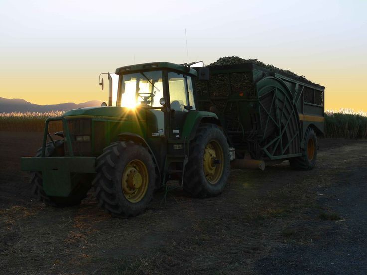 Driving back from an interview with 'A Ride to Remember' documentary maker Jayson Watkin I saw this John Deere full of sugarcane harvested within the last hours of the day.  The sun was almost down over the mountain but this photo shows how much cane one of these tippers can hold. Kind regards,  Paul Oliveri  100 Mile Author