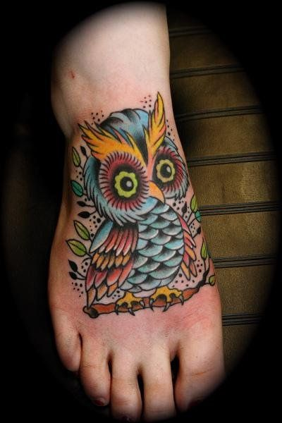 owl tattoo by Dave Kruseman Tattoo, via Flickr. Pretty brave for on the foot it has a lot of detail!