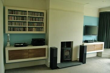 """"""" chimney breast alcoves as part of a reception room facelift. units are painted MDF with oak veneered doors. The existing fire surround was removed and the new opening formed to accommodate the wood burning stove with a polished slate hearth. Sockets for the electrical equipment are concealed"""""""