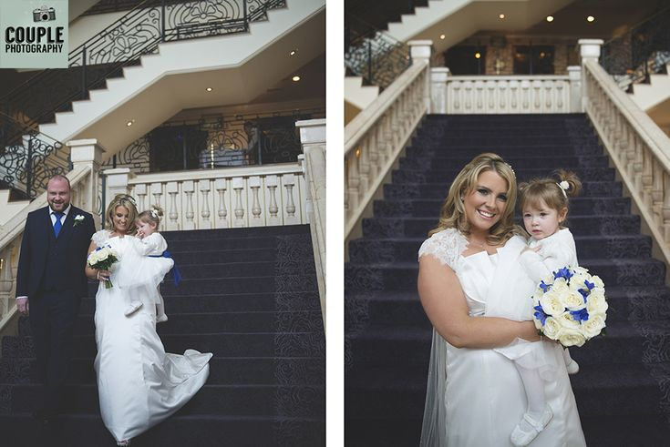 The bride comes down the amazing staircase and heads off to the church. Weddings at The Heritage Hotel by Couple Photography.