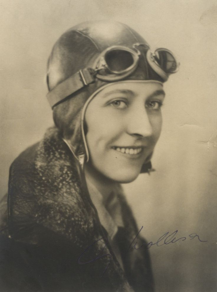 JOHNSON AMY: (1903-1941) English Pioneer Aviatrix. Vintage signed sepia 5 x 7 photograph of Johnson in a head and shoulders pose wearing her flying cap and goggles. Signed ('Amy Mollison') with her married name in fountain pen ink to the image, her first name across a dark area.