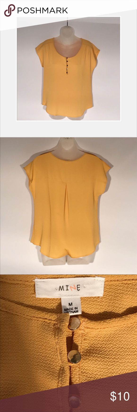 Short sleeve top Mustard yellow short sleeve top.  Has crepe polyester fabric and gold buttons.  Great condition. Tops