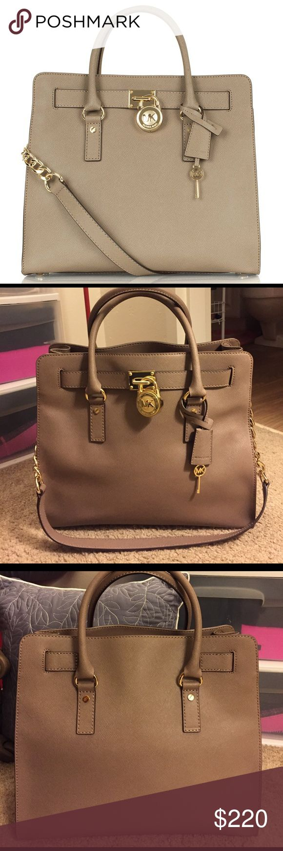Michael Kors Hamilton bag 100% authentic MK Hamilton tote bag. Taupe color with gold lock and chain. Perfect condition!!! No markings, rips, or tears. Only selling because I have so many purses! Comes with the original satin bag for storage! Price is firm. Michael Kors Bags