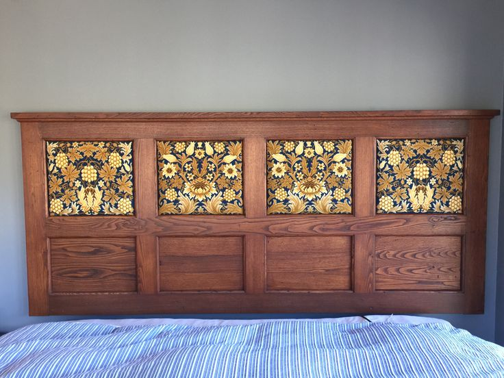 """Mary Schinke sent this photo of 4 Sunflower kits making a stunning headboard:  """"I've done so many of your kits and love them all. This is one favorite."""""""