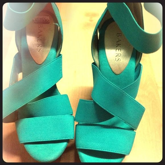 Turquoise heels Super high turquoise heels. Strapped heels with zipper on the back of heels. Worn only a few times. Still in good condition . bakers Shoes Heels